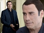You should have kept your hat on: John Travolta shows off bizarre two-tone hairstyle at Savages photocall