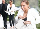 Her style needs some adjustment! Mel B struggles to keep her chest contained as she steps out to fashion lunch