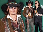 Downbeat: Johnny Depp looked solemn when he appeared at a book signing on the day a crew member died on the set of The Lone Ranger