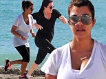 Keeping up! Kourtney and Khloe Kardashian were spotted on a beach run in Miami on Wednesday