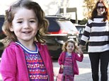 I'm a big girl now! Satyana shows off her new pink satchel as Alyson Hannigan takes her to preschool