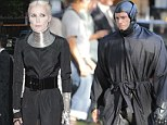 Did you borrow that look from Robocop? Daphne Guinness steps out with metallic neck brace and hand