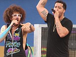 Split: LMFAO, pictured here performing in New York in June, have parted ways