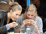 Tucking in: Lara Stone was seen enjoying a sandwich as she had lunch with a friend in Primrose Hill earlier today
