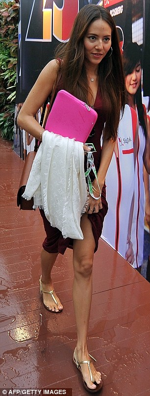 Ruining her look: Jessica was left unhappy after the downpour hit as she turned up to the Marina Bay Street Circuit