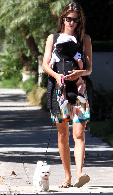 Model mother: Later on in the day Alessandra stepped out for a walk with her baby boy Noah and their pet dog