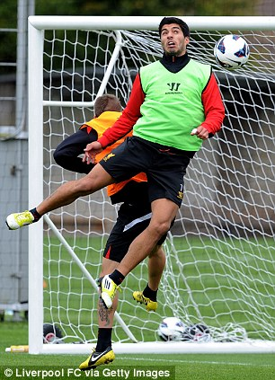 Head and shoulders above: Luis Suarez in training
