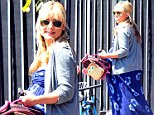 Sarah Michelle Gellar shows off her huge baby bump in a maxi dress as she carries her daughter, Charlotte's monkey backpack in one hand and holds her girl's hand with the other in Santa Monica.