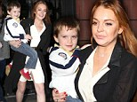 Don't quit your day job! Lindsay Lohan tries her hand at babysitting friend's young son as she emerges following arrest