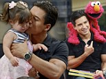 What do you mean Elmo's not real! Mario Lopez' daughter's horror as she meets her idol... on a puppeteer's hand