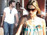 Grown-up time: Alessandra Ambrosio hits the shops with her fiancé as they buy their children presents