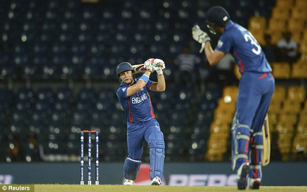 Evasive action: Hales gets out of the way as Wright drives back down the ground