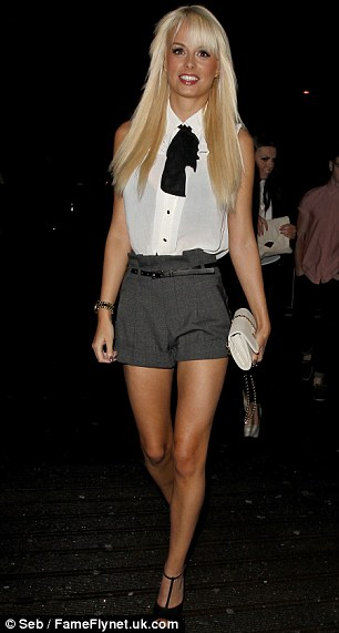 Conservative: The glamour model shied away from one of her usual eye-popping outfits, opting instead for a high-necked blouse and tailored shorts
