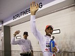 That's handy: Hamilton celebrates his fifth pole position of the season