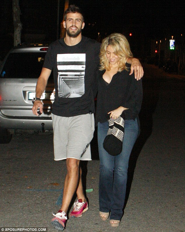 Table for three please! Shakira and boyfriend Gerard Pique headed out on a romantic date night in Barcelona, Spain, after announcing they are expecting their first child together