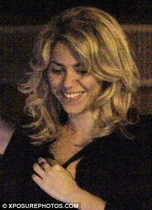 Radiant: The 35-year-old singer beamed with joy as the couple went for dinner and to the cinema