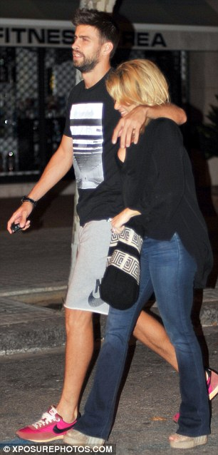 Covering up: Shakira wore a loose-fitting black jumper with a pair of flared jeans for the evening out