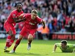 Hold on: Lambert celebrates