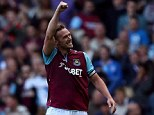 Captain fantastic: West Ham skipper Kevin Nolan punches the air to celebrate his late equaliser