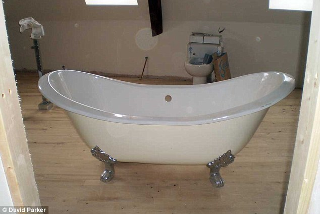Classy: Rolltop bath with silver feet former Lloyds boss Jessica Harper imported from England for her property