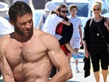 Wolverine's day out: Hugh Jackman takes a break from filming and heads to the beach with his wife and kids