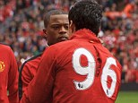 Face to face: Patrice Evra and Luis Suarez shook hands ahead of the match