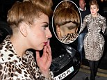 Lady Gaga flaunts head tattoo...and hides fuller frame under a leopard-print dress in Paris