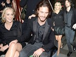 Sharon Stone and toyboy beau Martin Mica can't keep their hands off each other at Milan fashion store opening
