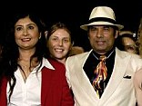 Centre of attention: Bikram and his wife Rajashree Choudhury pose with some of the competitors at a yoga competition in 2010