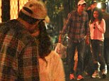 We'll get this to go! Ashton Kutcher and Mila Kunis share a smooch as they take home leftovers after romantic dinner date