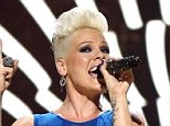 Bra flasher: Pink flaunted her bra under a blue sheer top while performing her hits on day two of the iHeartRadio Music Festival in Las Vegas