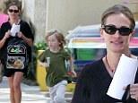 Malibu mum: Julia Roberts flashes her famous mega-watt smile as she dotes on son Henry