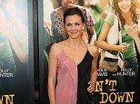 Indecisive: Maggie Gyllenhaal wasn't sure if she should go for a light or dark shade of dress for her New York premiere of Won't Back Down