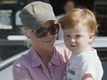 Single mum: Newly single Amy Poehler leaving a Petco store with her son in Beverly Hills