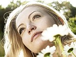 At one with nature: A pensive woman in a field