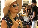 What controversy?: Paris and her new beau shop in Hawaii as she continues to brush off gay slur