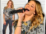 No tears this time! Happy LeAnn Rimes sings at charity show following rehab stint