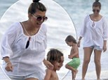 Kourtney Kardashian chills out with son Mason on South Beach, Miami. Little Mason was later seen kissing his mom's foot at their hotel swimming pool