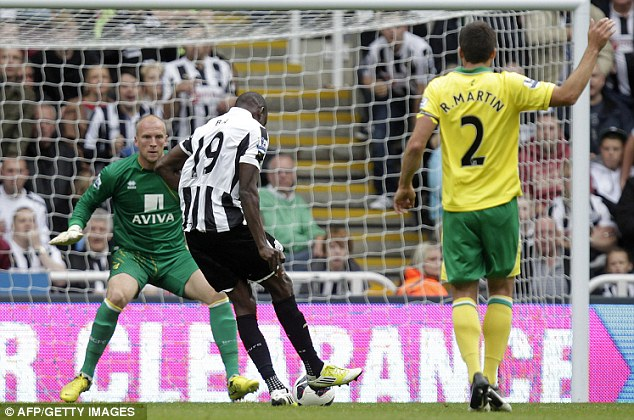 Man in form: Demba Ba tucks home his third goal in two games for Newcastle