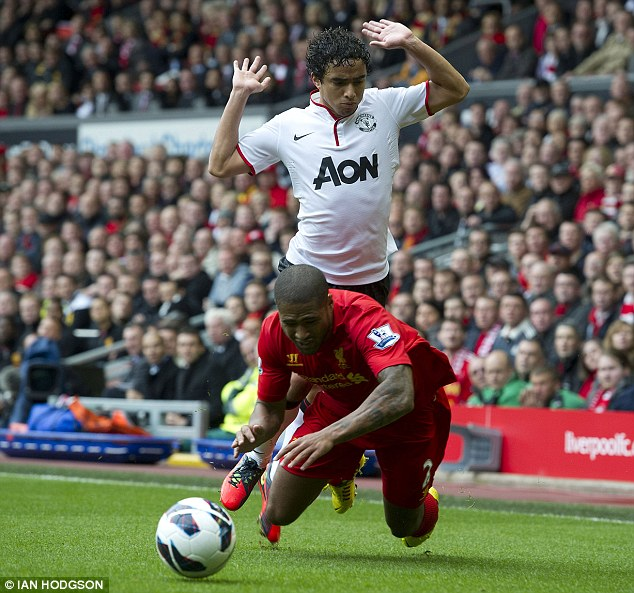 Bright start: Liverpool's Glen Johnson (red) is fouled by Manchester United's Rafael