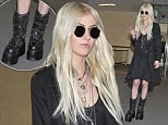 Pretty Reckless fashion sense: Taylor Momsen steps out in Tokyo with goth look and mammoth platform boots