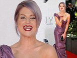 Purple rinse, purple rinse: Kelly Osbourne matches her red carpet gown to her bizarrely coloured lilac locks