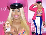 That's one way to sell a perfume! Nicki Minaj steps out in VERY low cut bra and a pink police officer hat for the launch of Pink Friday scent