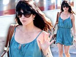 Beating the heat: Selma Blair flaunts her pale pins in bubble shorts after leaving spa