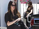 There's no hiding that bump now! Pregnant Megan Fox fails in her attempt to cover her growing curves as she indulges her cravings at lunch