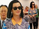 She's eclectic: Katy Perry switches up her style as she swaps tight dresses for an eye-catching blouse