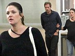 Heavily pregnant Drew Barrymore enjoys night out with husband Will Kopelman and her in-laws