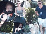 Afternoon stroll: TV chef Curtis Stone savors a walk with fiancee Lindsay Price, their 10-month-old son Hudson and their dog