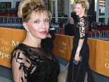 She scrubs up well: Grungy rocker Courtney Love attends the opening night of the New York Metropolitan opera in a demure gown clutching her reading glasses