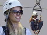 The only way is up! Paris Hilton distracts herself from gay slur scandal with a spot of ziplining in Hawaii